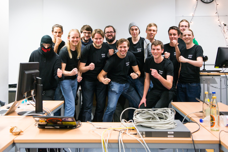 group of hackers posing for a photo